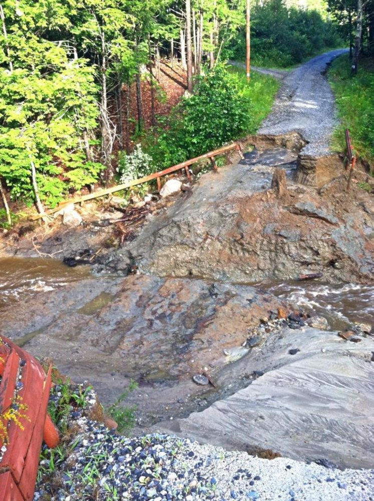 Turkey Ridge Lane was washed out after heavy rain in Freeport.
