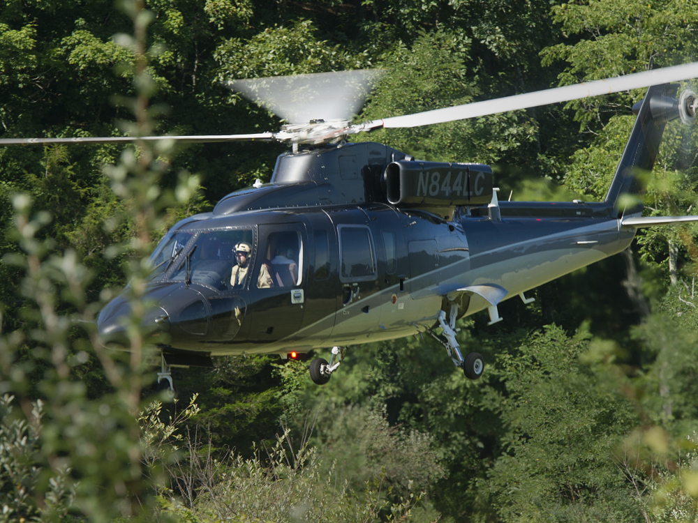 A search helicopter lands close to where an Air Force F-15C fighter jet based in Massachusetts crashed near Deerfield, Va., on Wednesday.