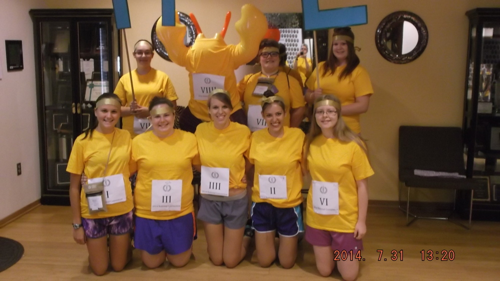 The Maine delegation prepares for the Race Atalanta for the Purple and Gold spirit competition at the 2014 National Junior Classical League Convention. Front, from left, are Siana Emery, Emily Mitchell, Laura Rose, Alexis Elder and Kathryn Truman; and back, from left, are Dakota Jackson, mascot Lobster Stu, Teresa Easterbrooks and Sarah Truman.