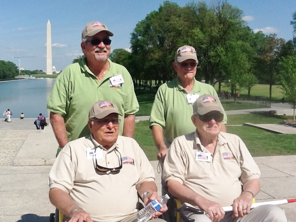The brothers with their guardians in front of the Washington Monument. The Butler brothers celebrated their 89th birthday in May. The trip was provided at no expense through the Honor Flight Network.