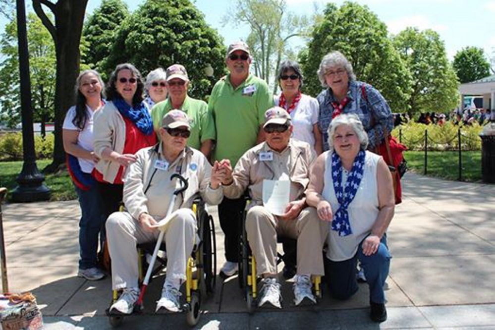 At the World War II Memorial, front, from left, is Robert Butler, holding hands with his twin brother Richard Butler, along with daughter Karen Roak of Augusta; and back, from left, are daughter Dee Dee Love of Farmingdale, daughter Nancy Butler-Smith of Monmouth, daughter Debbie Sylvester of Manchester, Robert's guardian Andy Frederick of Florida, Richard's guardian Dennis McCullough of Florida, daughter Judy Moody of Gardiner, and daughter Linda Pekins of Farmingdale. Robert has a daughter, Lori Craig of Houlton. The brothers are holding letters of recognition that they received from Sen. Angus King's office.