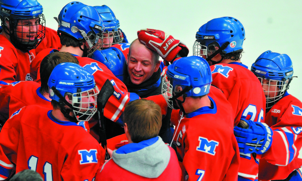 Members of the Messalonskee hockey team mob coach Mike Latendresse after they defeated Brewer 5-2 in the 2012 Eastern B championship game at Alfond Arena in Orono. Latendresse recently resigned from Messalonskee to pursue other opportunities.