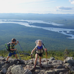 The Kallin children, Madeline, 8, and Nathan, 9, hike at Bigelow Preserve with Flagstaff Lake in the background. The Dresden family started out on the AT in Georgia in April and hopes to finish atop Mount Katahdin on Monday.