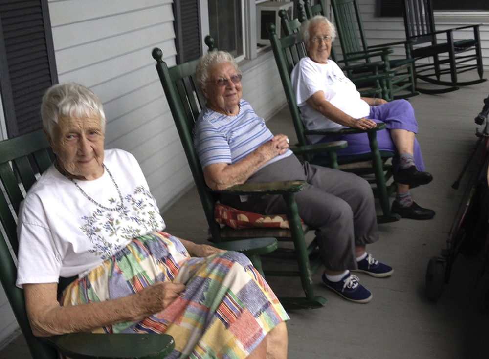 Residents of St. Mark's Home in Augusta, from left, Margaret Jamison, Eva Sherwood and Nona Treworgy rock in the shade of the east-facing porch and talk about how much they have enjoyed living there. The home is slated to close by the end of the year, and they will have to move.