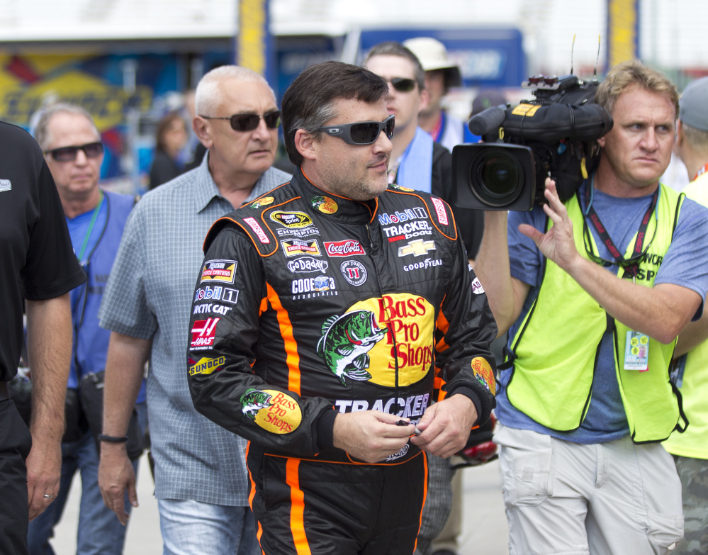 NASCAR driver Tony Stewart walks to his car during practice Friday for Sunday's NASCAR race at Atlanta Motor Speedway in Hampton, Ga. Sunday's race will be his first since his car struck and killed a fellow driver during a sprint race in New York three weeks ago.