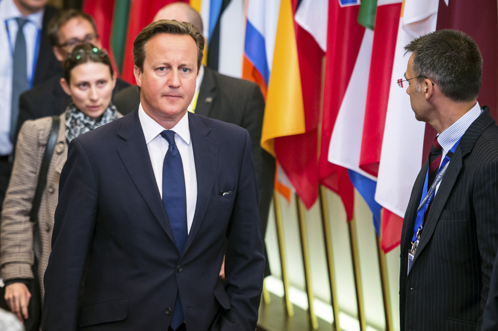 British Prime Minister David Cameron leaves the EU Council building at the end of an EU summit in Brussels, early Sunday.