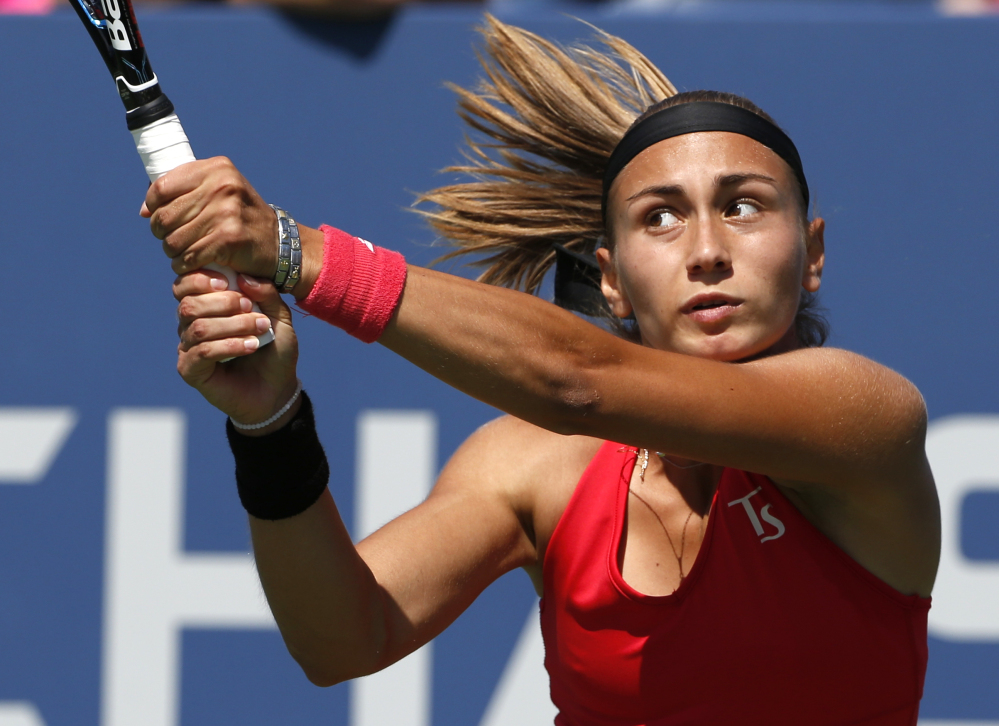 Aleksandra Krunic returns a shot against Petra Kvitova during their third-round match Saturday at the U.S. Open. Krunic upset the third-seeded Kvitova, 6-4, 6-4.