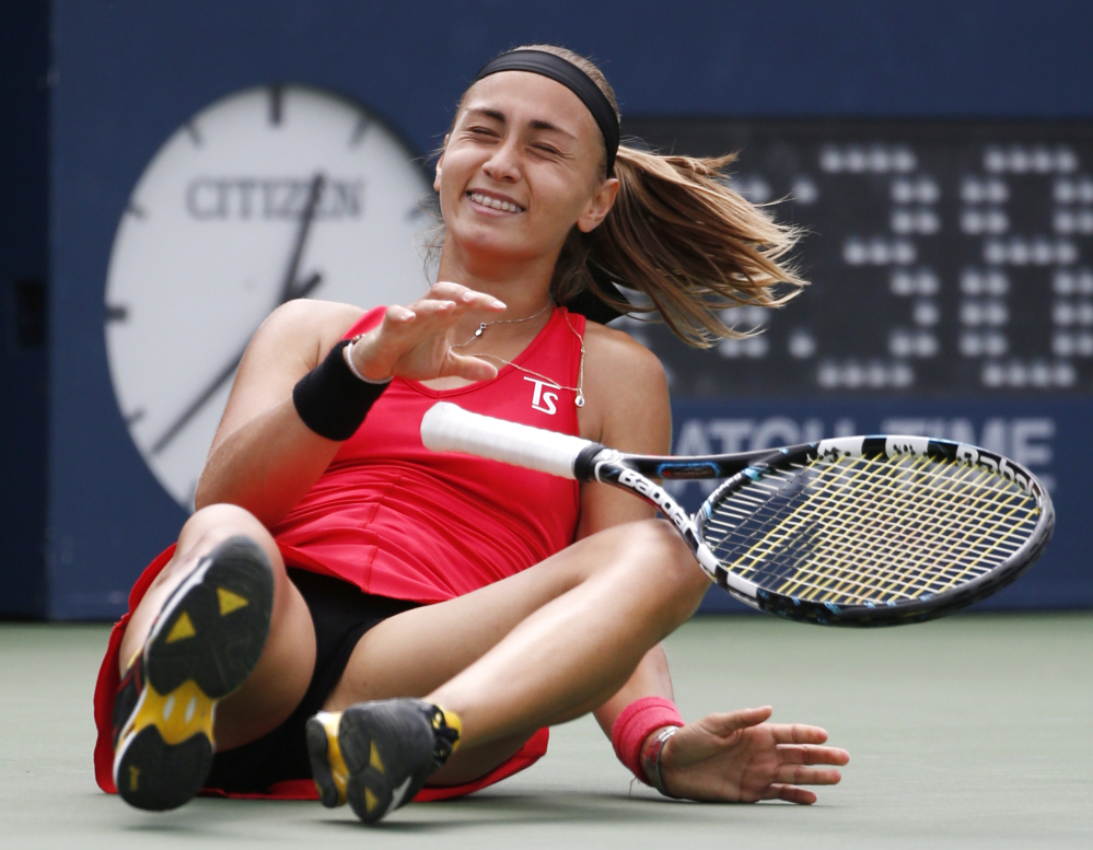 Aleksandra Krunic drops to the court after defeating Petra Kvitova in the third round of the U.S. Open in New York. Krunic won, 6-4, 6-4.
