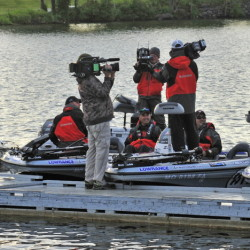 Competitors, production crew members and judges stand on the dock or sit in boats around 6:30 a.m. Saturday at China Lake in China just before the start of a Major League Fishing event.