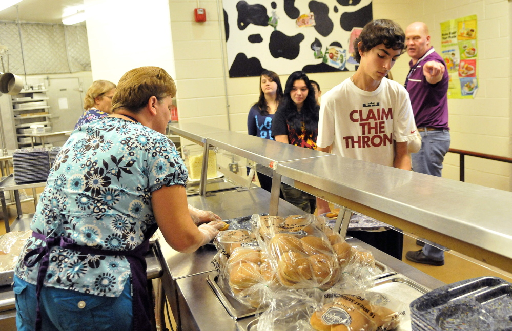 Students get lunch at the cafeteria Friday during school at Waterville Junior High School.