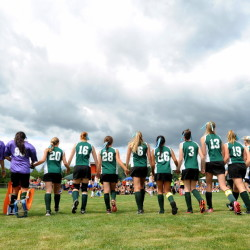 The Winthrop High School field hockey team walks across the field holding hands before a game during Play Day hosted by Winslow High School in Winslow on Saturday.