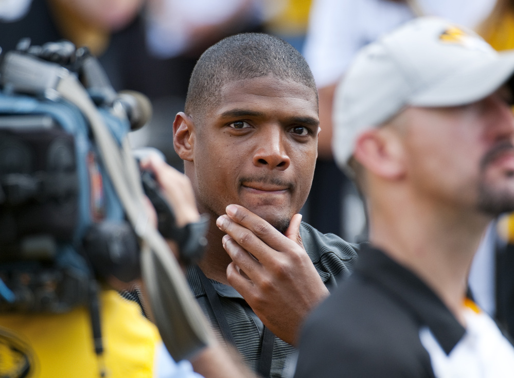 Michael Sam watches pregame festivities before the start of the South Dakota State-Missouri game on Saturday. Sam, who played for Missouri last year, is first openly gay player drafted by an NFL team. He was released by the Rams on Saturday.