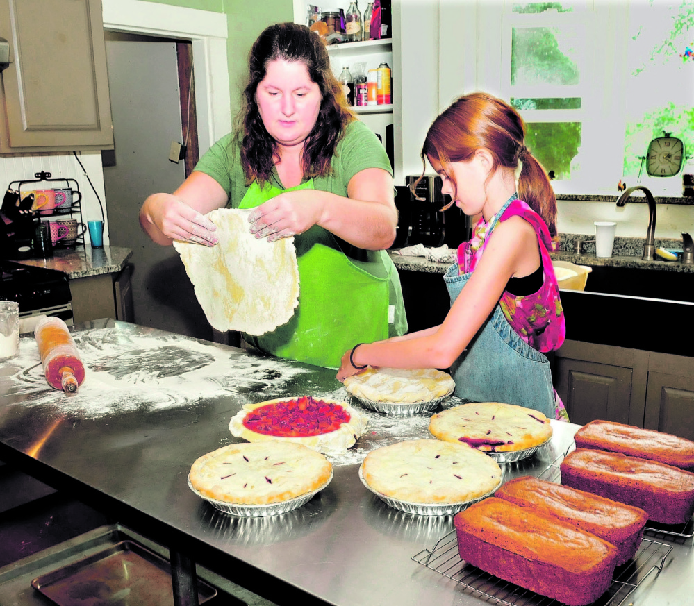 Jenny McLean and her daughter Hannah make pies in the kitchen of the McLean Family Farm and Bakery on South Reynolds Road in Winslow.