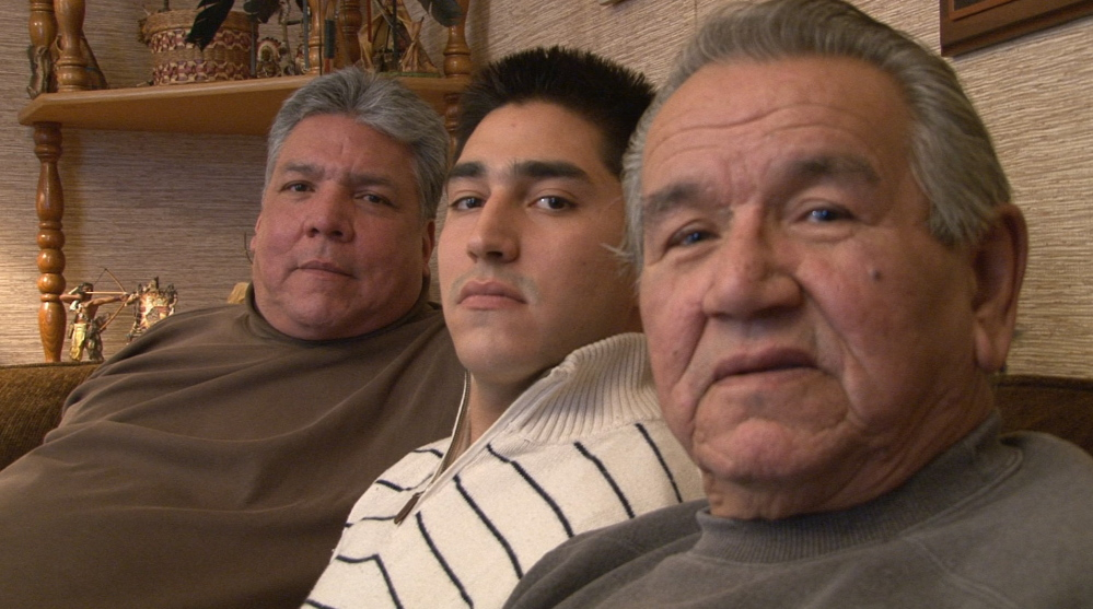 Three generations of the Francis family – from left, Randy Hinton, Michael-Corey Francis Hinton and Peter Francis Jr. – sit for an interview with documentary filmmaker Ben Levine. Levine is producing a film about the crimes against the Francis and Altvater families and the Passamaquoddy people. Photo captured from video by Ben Levine