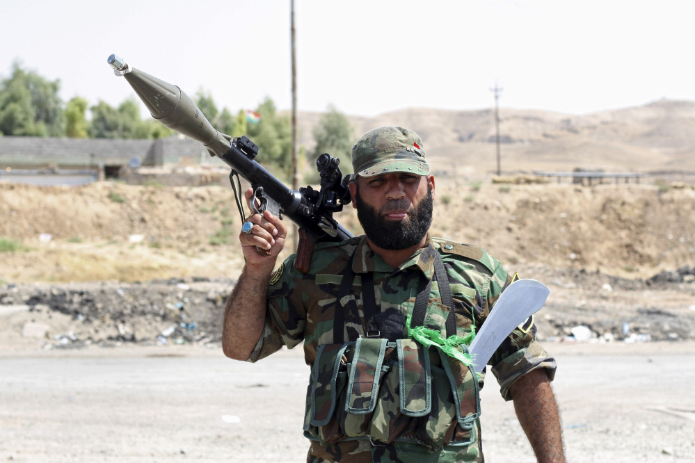 A Shiite militiaman stands guard in Amirli, where 15,000 Shiite Turkmens were stranded in the farming community surrounded by militants since mid-July, 105 miles (170 kilometers) north of Baghdad, Iraq.  Iraqi security forces and Shiite militiamen on Sunday broke a six-week siege imposed by the Islamic State extremist group on the town of Amirli, following U.S. airstrikes against the Sunni militants' positions, officials said.