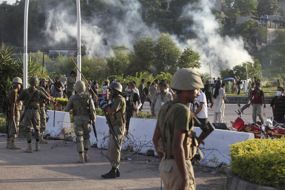 Pakistani paramilitary troops stand guard during a clash between police and protesters in Islamabad, Pakistan on Monday.