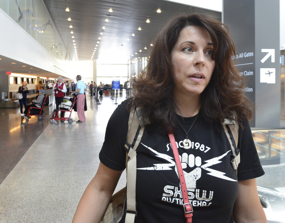 Susan Sanders, of Los Angeles, is among travelers at Portland International Jetport who gave their views Tuesday about quarrels between passengers who want to recline their seats and passengers behind them who object to it.
