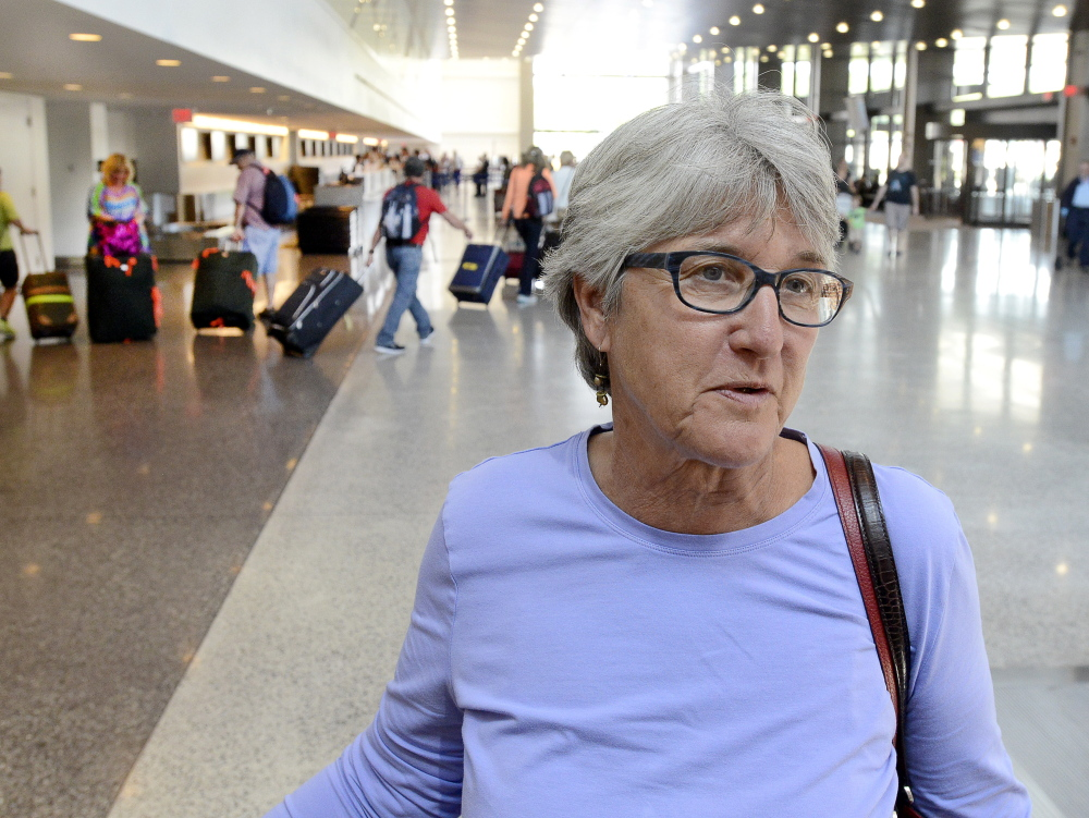 Leslie Thurston, of Seattle, is among travelers at Portland International Jetport who gave their views Tuesday about quarrels between passengers who want to recline their seats and passengers behind them who object to it.