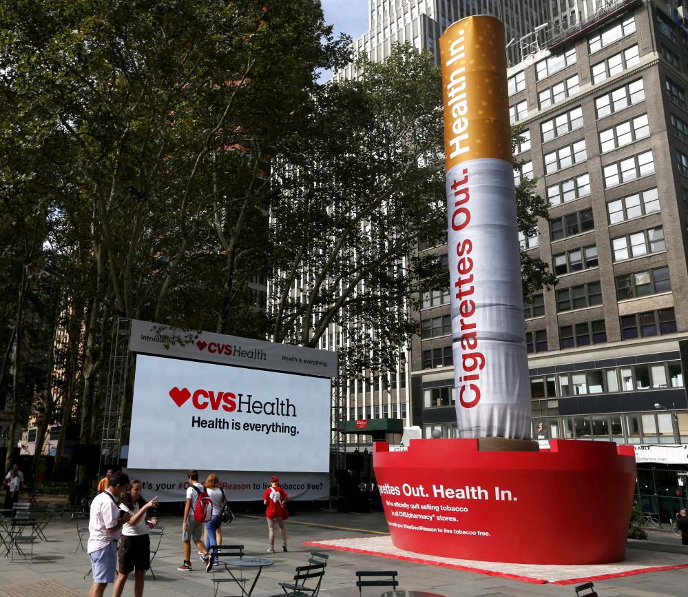 An inflatable cigarette is displayed in New York on Wednesday to coincide with CVS' announcement to change its name and stop selling tobacco products.