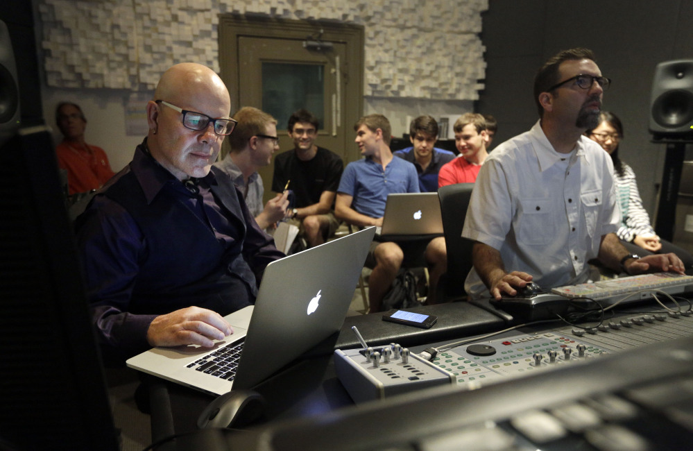 """Musician Thomas Dolby, left, prepares for his class, """"Sound on Film,"""" at Johns Hopkins University's Peabody Institute music conservatory in Baltimore. Dolby, perhaps best known for his 1980's song """"She Blinded Me With Science,"""" has made several careers at the nexus of sound and electronics."""