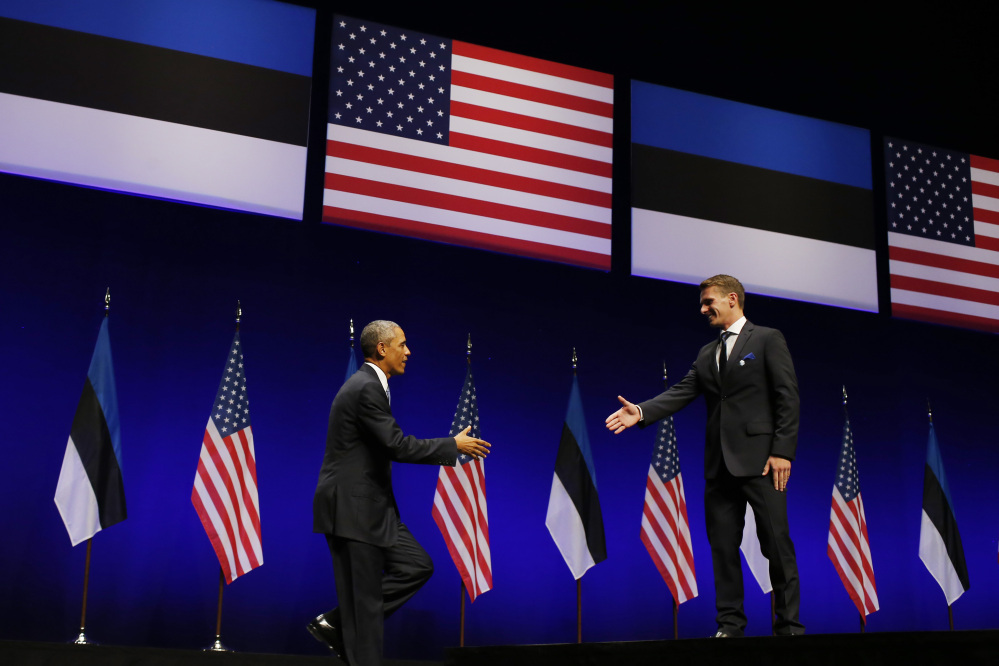 U.S. President Barack Obama is introduced by Oskar Poola, 26, a student at Tallinn University of Technology, at Nordea Concert Hall in Tallinn, Estonia, on Wednesday.