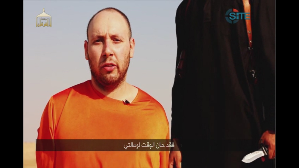 This image made from video posted on the Internet by Islamic State militants and provided by the SITE Intelligence Group, a U.S. terrorism watchdog, appears to show journalist Steven Sotloff before he was killed.