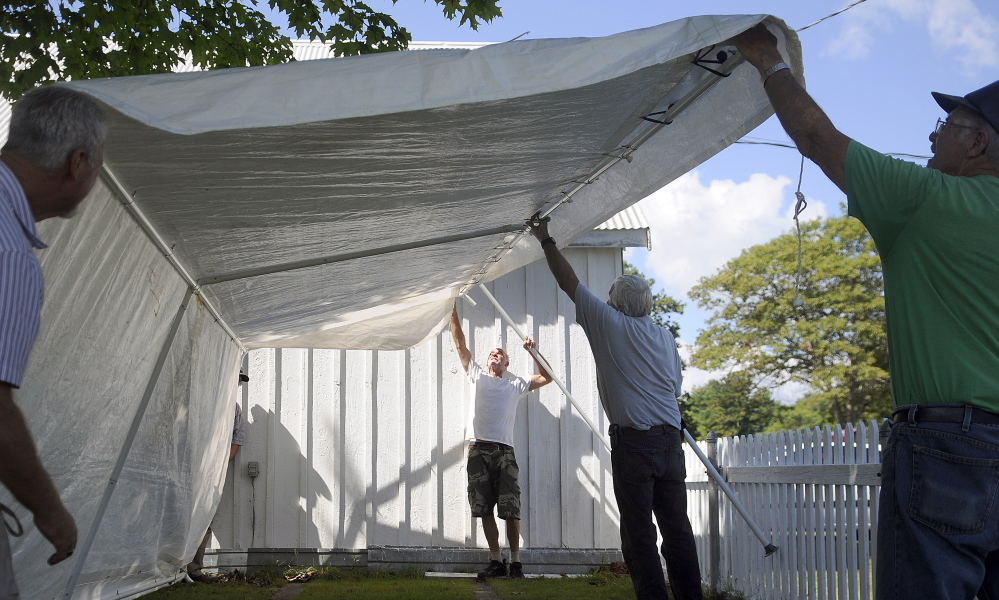 Volunteers erect one of ten canopies for vendors Wednesday at the Litchfield Fair. The annual agricultural exhibition begins Friday and wraps up Sunday.