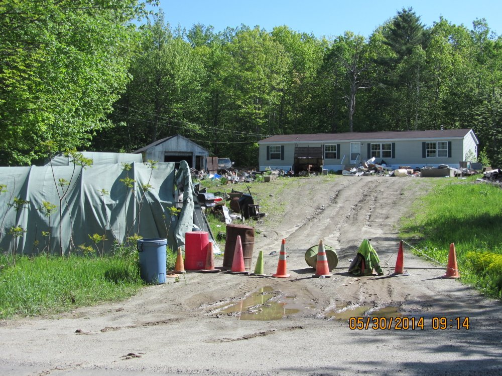 This property on North Wayne Avenue, Wayne, is the subject of a civil lawsuit in Kennebec County Superior Court. The town is asking a court to fine property owner Earle Welch Jr.; to order him to clean it up within 30 days; and, if he fails to do so, to allow the town to do the cleanup and bill him.