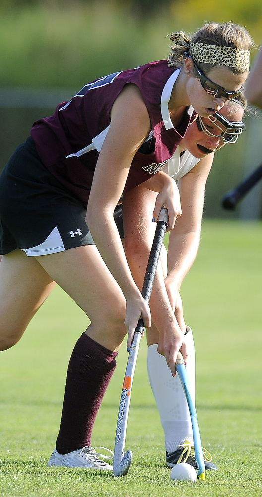 GARDINER, ME - SEPTEMBER: Gardiner Area High School's Emily Michaud, right, contains Thursday September 4, 2014 past Nokomis High School's Olivia Brown during a field hockey match up in Gardiner. (Photo by Andy Molloy/Staff Photographer)