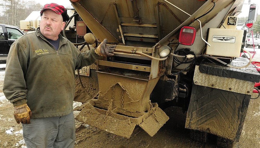 Chris Ellis talks about the calcium chloride dispensers on his plow trucks in this December 2013 file photo at Ellis Construction in Farmingdale.