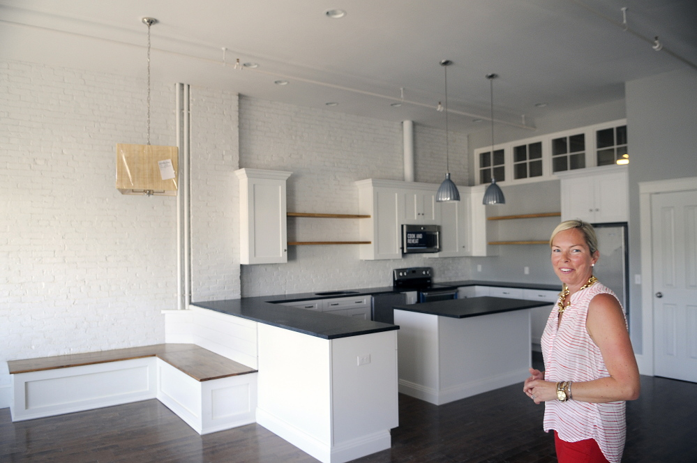 Laura Gall leads a tour of a third-floor luxury apartment at 190 Water St. in Augusta on Friday, where she oversaw the renovation of the building owned by her husband, Jason, and his brother, Ryan.