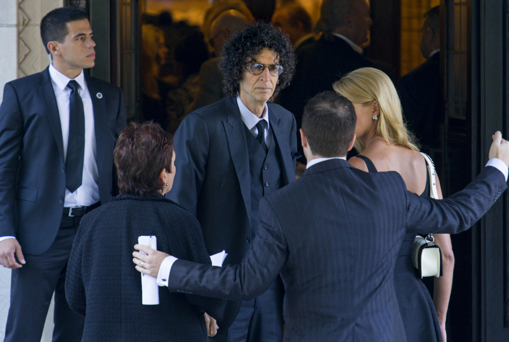 Howard Stern, center, arrives at a funeral service for comedian Joan Rivers at Temple Emanu-El in New York on Sunday.