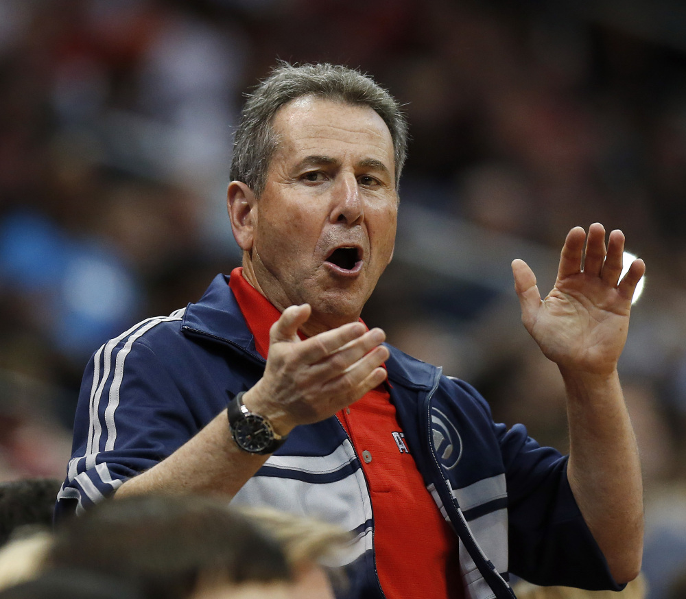 FILE - In this April 26, 2014, file photo, Atlanta Hawks co-owner Bruce Levenson cheers from the stands in the second half of Game 4 of an NBA basketball first-round playoff series against the Indiana Pacers in Atlanta. Levenson said Sunday, Sept. 7, 2014, he is selling his controlling interest in the team, in part due to an inflammatory email he said he wrote in an attempt