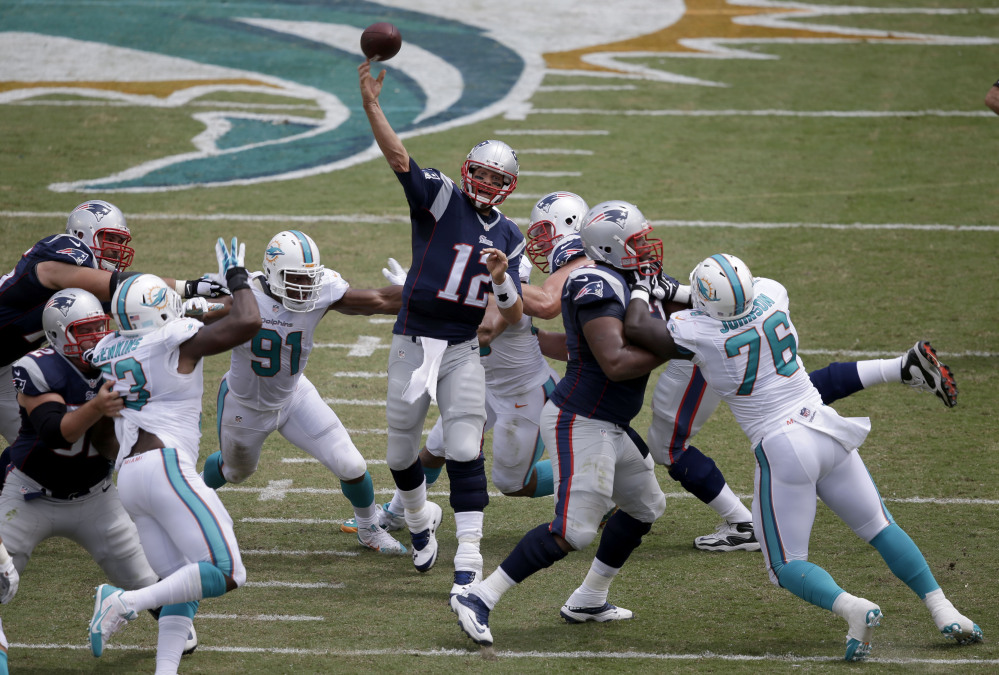 Patriots quarterback Tom Brady passes against the Miami Dolphins in the first half Sunday at Miami Gardens, Fla.