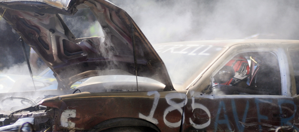 Matt Averill drives his Cadillac toward an opponent Sunday during the demolition derby held at the Litchfield Fair.