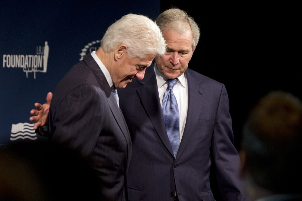 Former Presidents Bill Clinton, left, and George W. Bush participate in the Presidential Leadership Scholars Program launch on Monday at The Newseum in Washington.