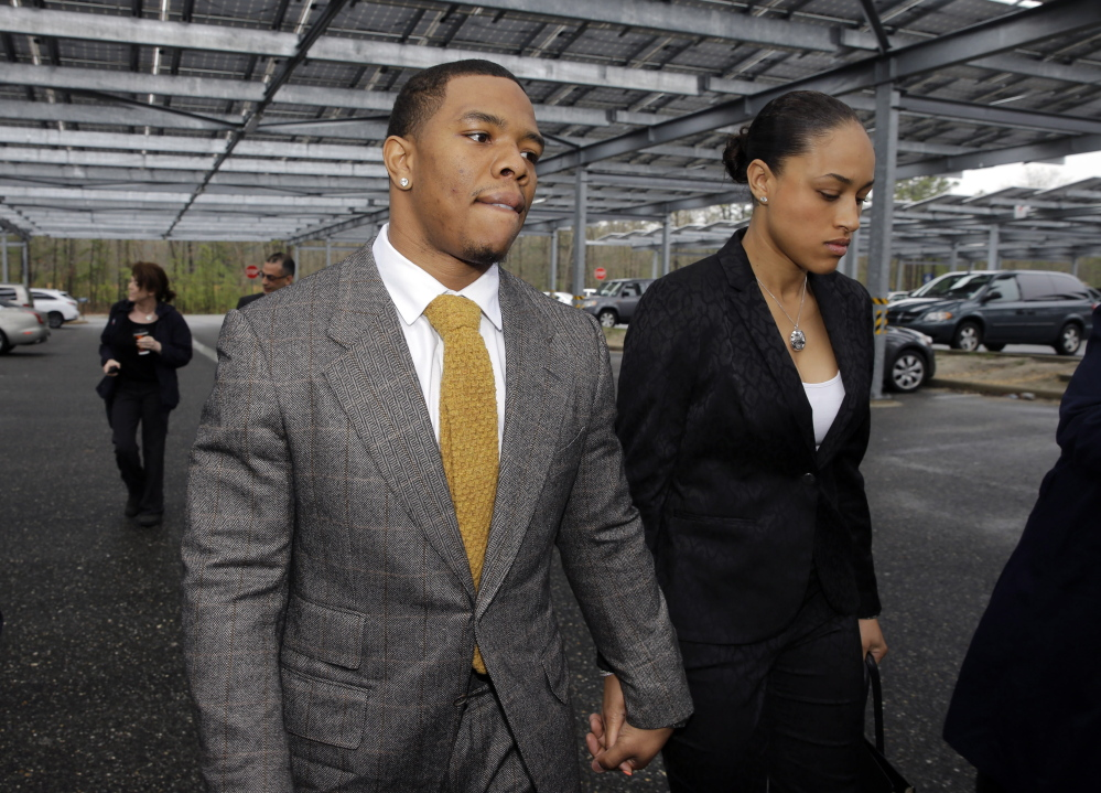Baltimore Ravens football player Ray Rice holds hands with his wife, Janay Palmer, in May. Other players have weighed in on his suspension following the release of a video that appears to show him knocking Janay Palmer to the ground.