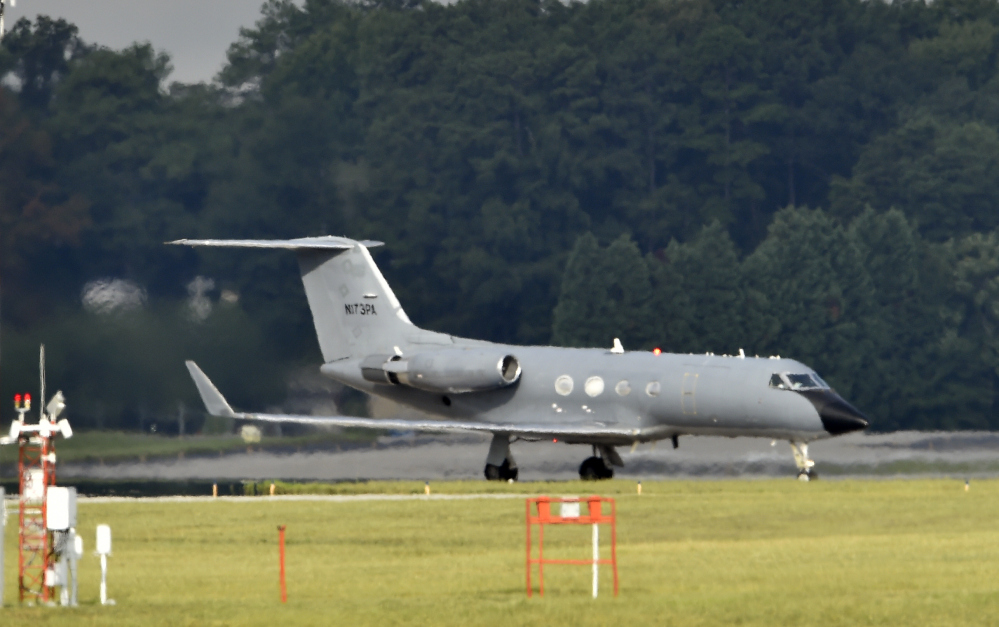 An airplane transporting an American infected with the deadly Ebola virus in West Africa, lands at Dobbins Air Reserve Base Tuesday in Marietta, Ga.