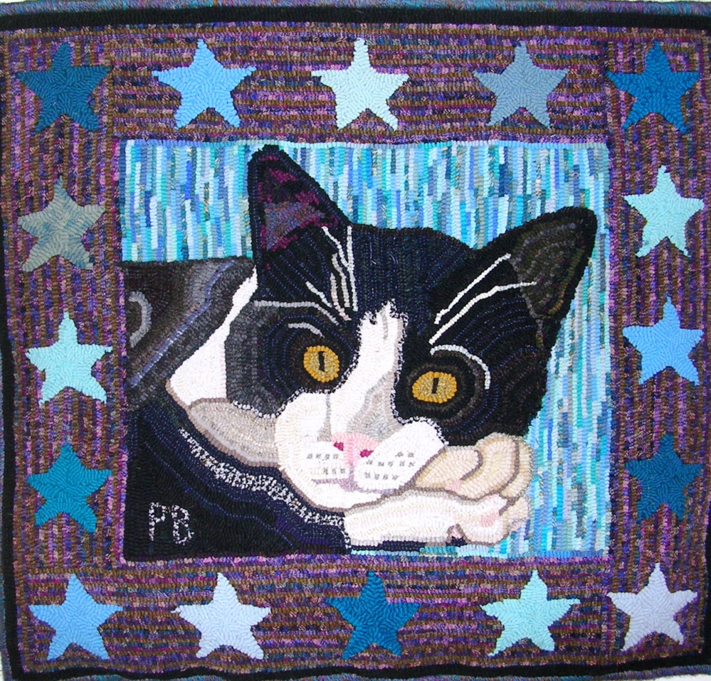"""Cat with Stars,"" a hooked rug by Paula Benne is among the artwork on display at the Fire Station on Saturday during Whitefield Community Days."