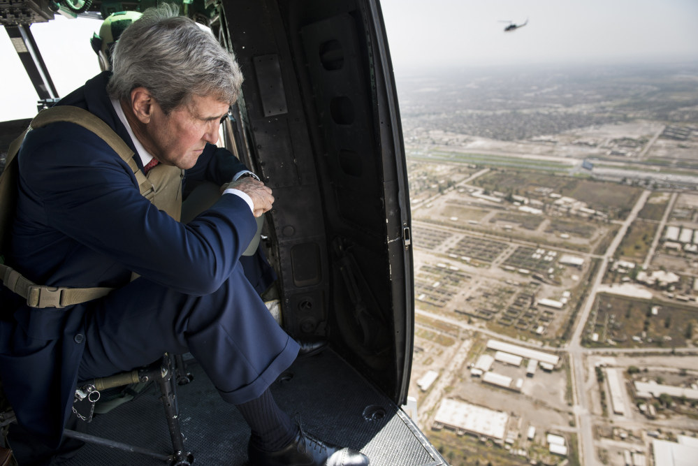 U.S. Secretary of State John Kerry looks out from a helicopter over Baghdad Wednesday. Kerry is in the Mideast to discuss ways to bolster the stability of the new Iraqi government and combat the Islamic State militant group that has taken over large swaths of Iraq and Syria.