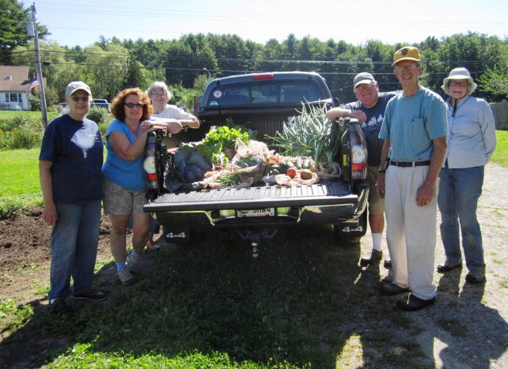 Master Gardener volunteers share their harvest. From left: Virginia Hill, Lori Bryant, Beth Maxwell, John Welsh, Paul Fenton and Merry Fossel.