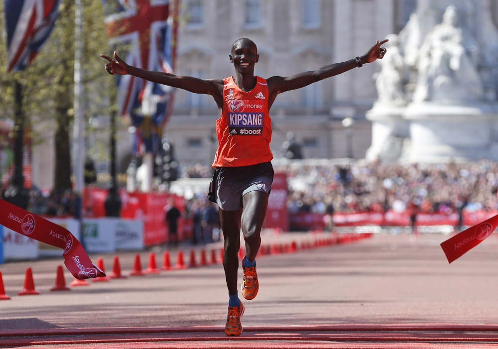 In this April 13, 2014, file photo, Wilson Kipsang of Kenya celebrates his win as he crosses the finish line at the London Marathon.