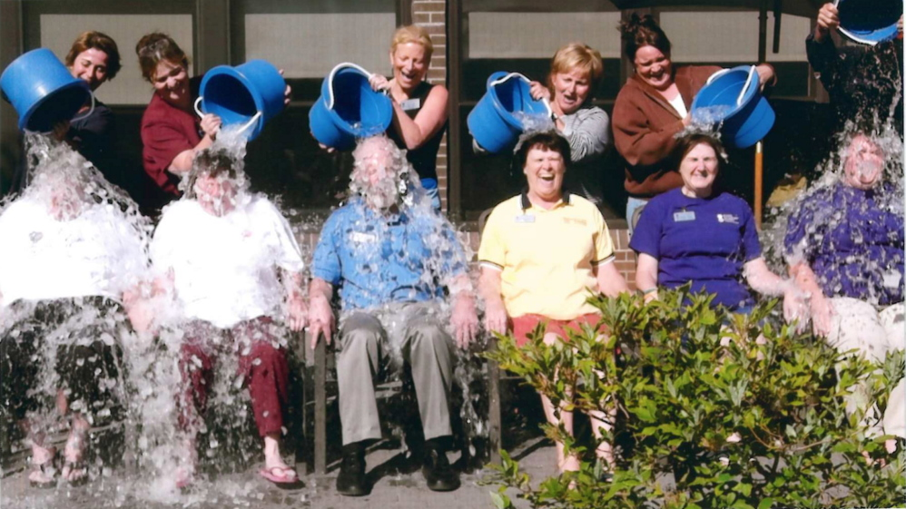 The Maine Veterans' Home recently participated in the ALS ice bucket challenge and raised more than $300. Maine First Lady Ann LePage and humorist Gary Crocker attended the event. From left are staff members Leslie Pelletier, Lisa Brann, Deb Fournier, LePage, Emily Kane, Crocker. Seated, from left, are staff members Nicky Wight, Judy Fortin, Kelley Kash, Gail Hillstrom, Becky Thayer and Cathi Seraph.