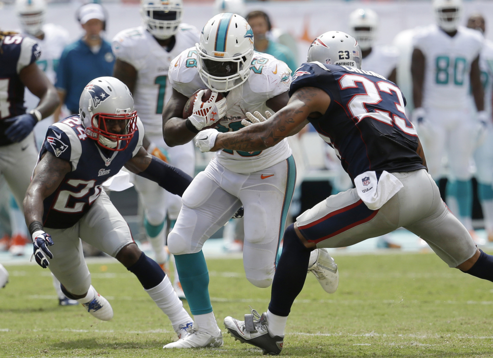 The New England Patriots allowed Miami Dolphins running back Knowshon Moreno (28) to rush for 191 yards during the Dolphins's 33-20 win. The Patriots don't have an easier task this week when they play Adrian Peterson and the Minnesota Vikings.