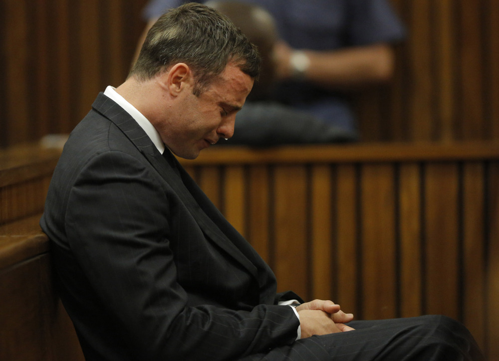 Oscar Pistorius cries in the dock in Pretoria Thursday, as Judge Thokozile Masipa reads notes on her verdict in Pistorius' murder trial.