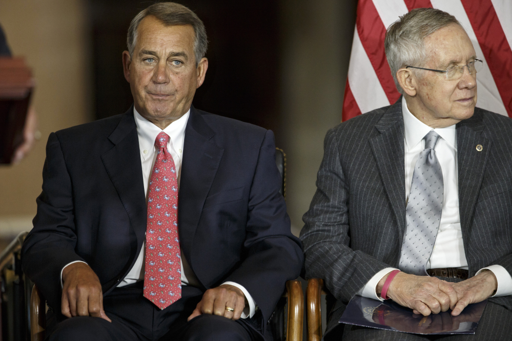 House Speaker John Boehner of Ohio, left, sits with Senate Majority Leader Harry Reid of Nevada, Wednesday on Capitol Hill. Behind the scenes, leaders are trying to put finishing touches on legislation preventing an Oct. 1 federal shutdown and financing the government into December, when Congress will return to work.