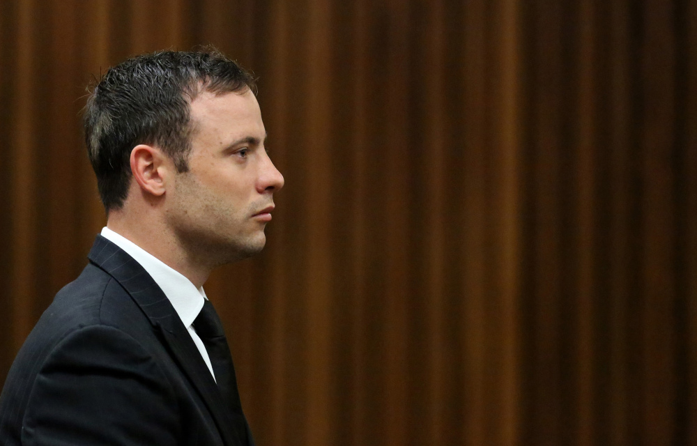 Oscar Pistorius looks straight ahead in court in Pretoria Friday as Judge Thokozile Masipa finds him guilty of culpable homicide for the shooting death of his girlfriend Reeva Steenkamp. The judge also ruled that the athlete was guilty of unlawfully firing a gun in a public place when a friend's pistol he was handling discharged under a table in a restaurant in Johannesburg in early 2013 — weeks before Steenkamp's killing.