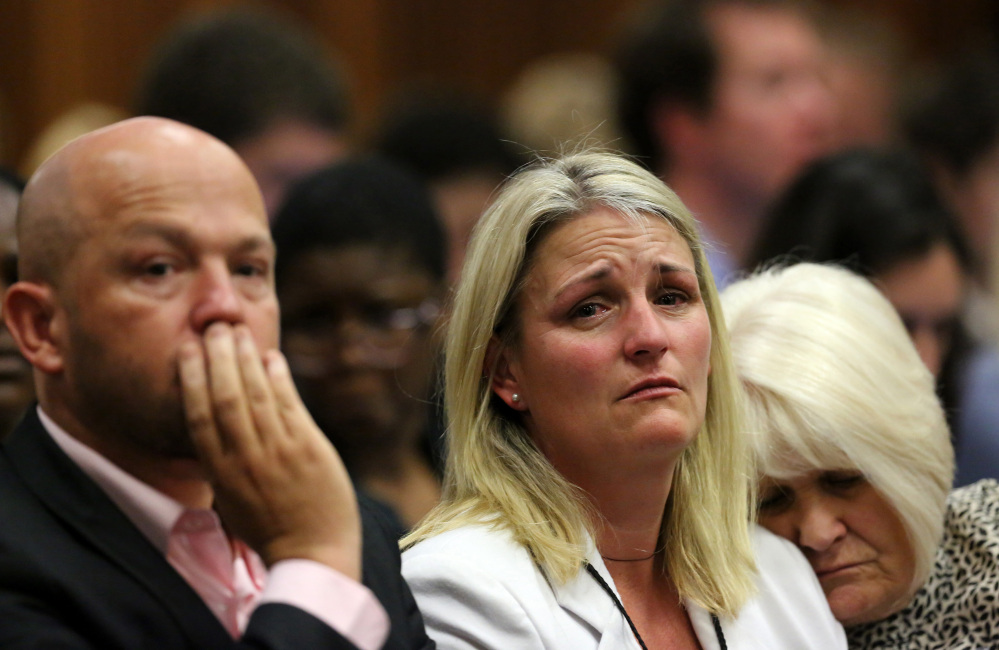Family members of the late Reeva Steenkamp listen as judgment is passed on Oscar Pistorius in court in Pretoria, South Africa, Friday, Sept. 12, 2014.  Judge Thokozile Masipa found Pistorius guilty of culpable homicide for the shooting death of his girlfriend Reeva Steenkamp.