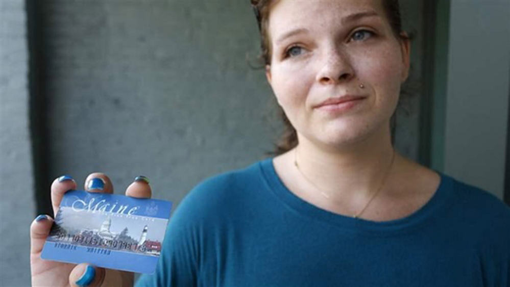 Stormie Whitten, 25, shows her Maine EBT card after shopping for groceries. Portland Press Herald photo