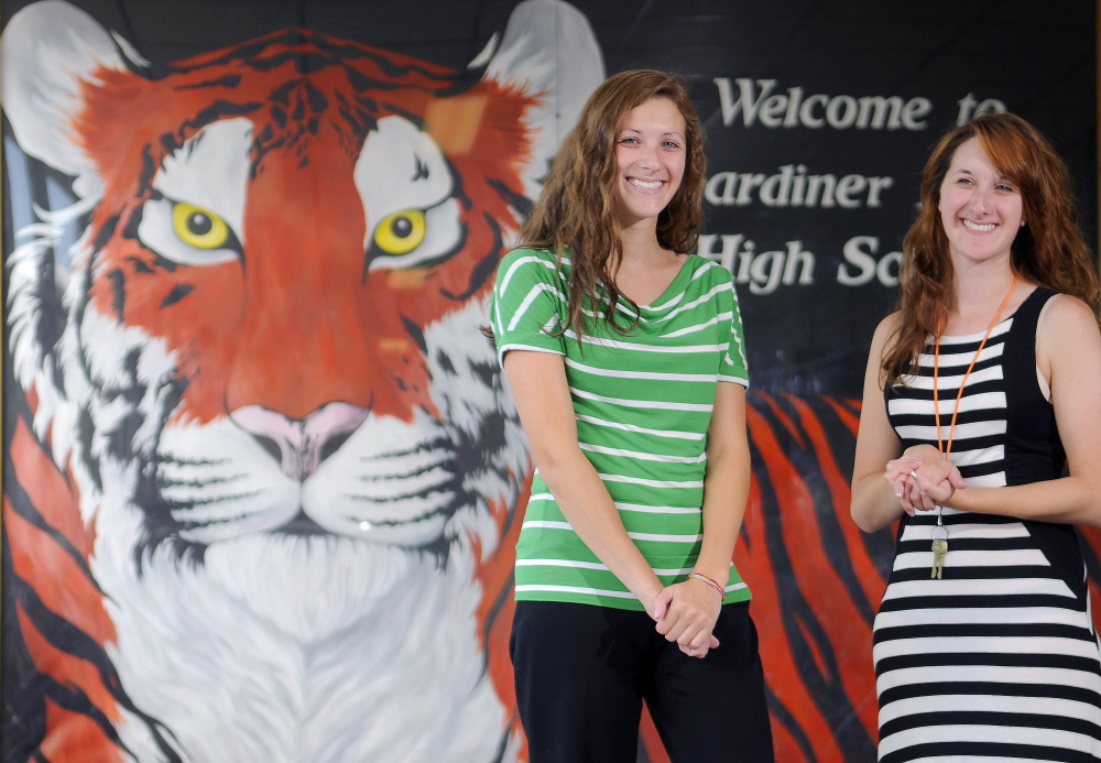 Twins Katie, left, and Emily Collins graduated from Gardiner Area High School, and both now teach there. The West Gardiner women said last week they are excited about working at their alma mater.